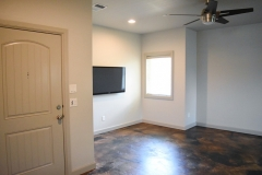 930 Flats living area with 50-inch flat TV mounted to wall with basic cable included