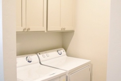 930 Flats Laundry room equipped with full-size washer dryer